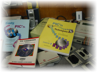 PIC Master Development System & ProMate II Programmer In The Backgound
